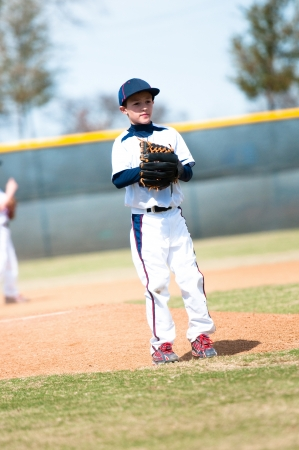 Little league baseball pitcher getting ready to throw the ball. Stock Photo