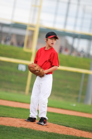 pitching: Young baseball player looking at the batter. Stock Photo