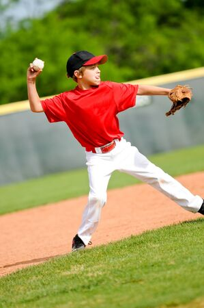 little league: Youth baseball player throwing ball Stock Photo
