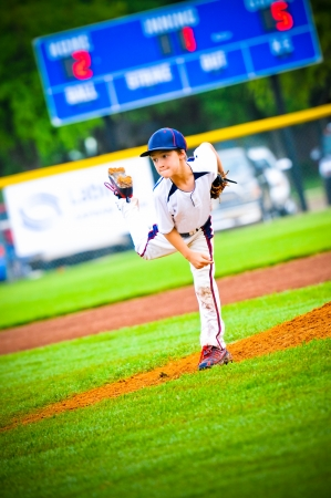Little league baseball pitcher after a pitch Stock Photo