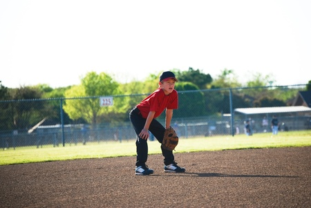 Little league baseball player getting ready for ball. photo