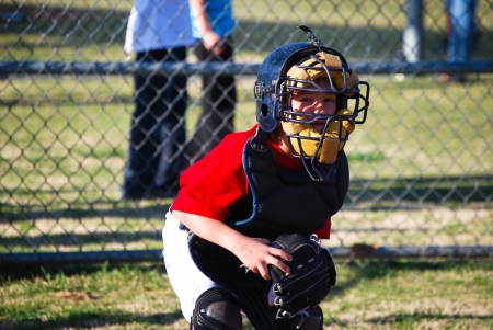 Lilttle league baseball catcher looking at camera. Stock Photo