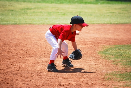 little league: Little league short stop in ready position.