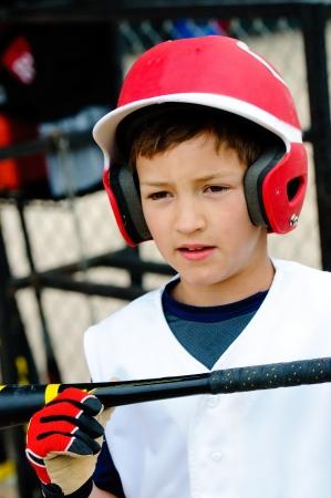 upclose: Up-close shot of little league baseball boy about to bat.