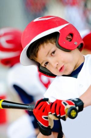 ballplayer: Little league baseball player swinging the bat up close. Stock Photo