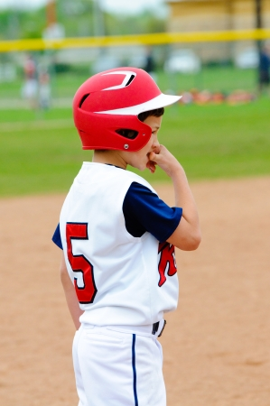 Llittle league player nervous on base. photo