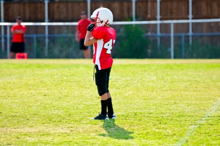 football cleats: Youth football player on the field