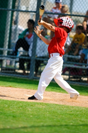 Young baseball boy swinging the bat. photo