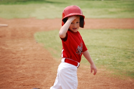 Little league baseball player during a game. Stock Photo