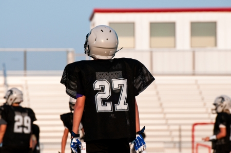 youth football: Youth american football player on the field during a game. Stock Photo