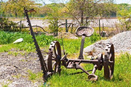 old tractors: Old rusty tractor on farmland.
