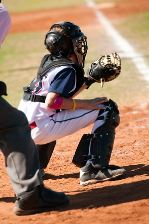 Baseball youth catcher during a game. photo