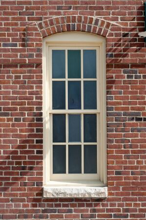 glass brick: Antique window on the side of a brick wall