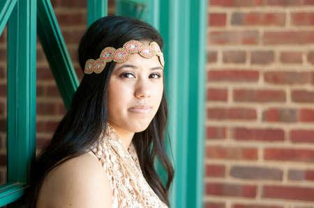 outdoor shot: Outdoor shot of pretty teen girl wearing headband Stock Photo