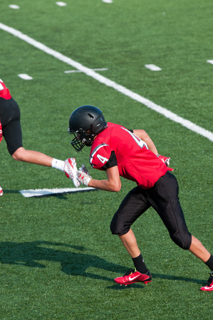 American football boy during a game on the field. Stock Photo