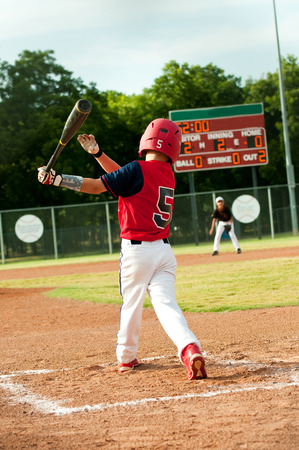 little league: Little league american baseball kid batting