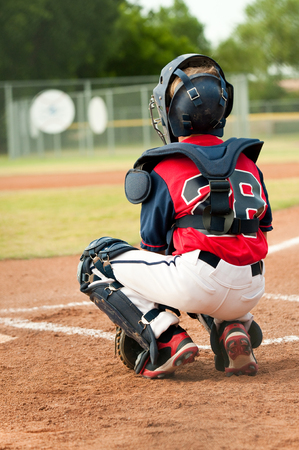 little league: Little league baseball boy from behind. Stock Photo