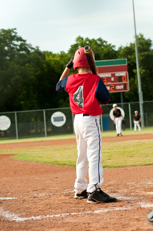 little league: Young little league baseball batter Stock Photo