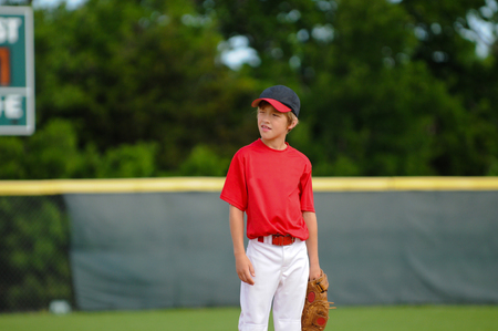 little league: Young little league baseball player during a game.