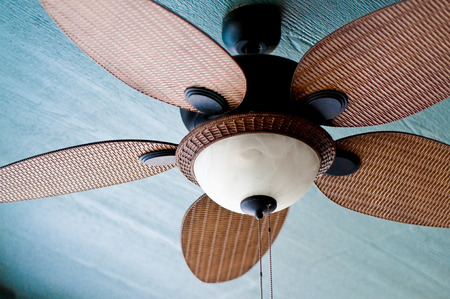 Decorative ceiling fan on porch of home. Banque d'images