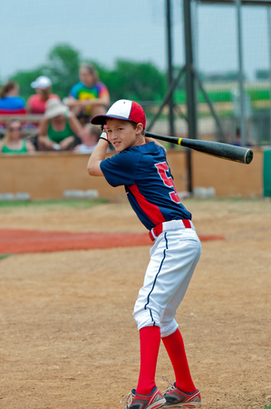 little league: Youth little league baseball boy getting ready to bat. Stock Photo
