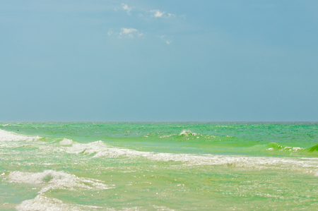 destin: Background of emerald green ocean with blue sky in Destin, Florida USA.