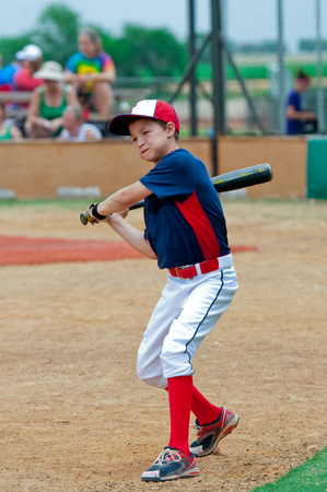 Youth little league baseball boy getting ready to bat. Stock Photo