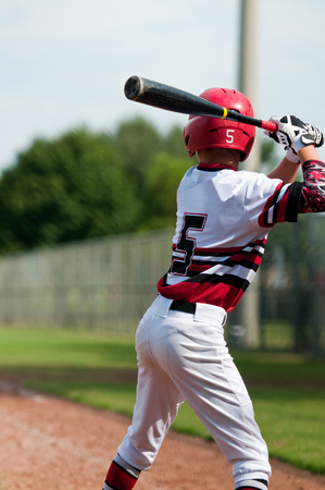 little league: Little league baseball player getting ready to swing the bat. Stock Photo