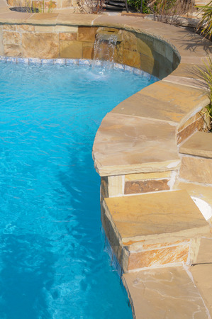 residential home: Luxurious swimming pool in backyard of a residential home. Stock Photo