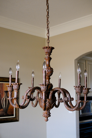 fixture: Wooden Light fixture in the interior of a home.