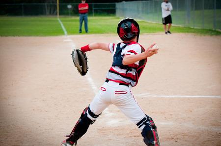 American baseball catcher throwing ball.