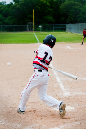 batting: American youth baseball player batting. Stock Photo