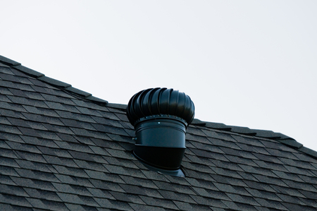 attic: Air ventilation on top of a roof.