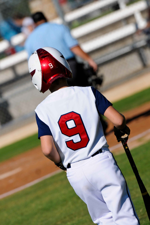 little league: American little league baseball player ready to bat from behind. Stock Photo