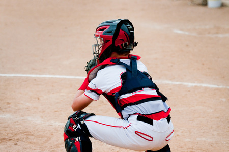 baseball catcher: American little league baseball catcher  behind home plate.