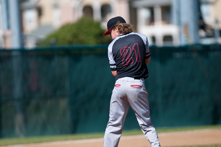 pitching: High school pitcher on the mound. Stock Photo