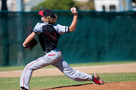 American teenage high school pitcher on the mound during a game. Stock fotó - 65700175