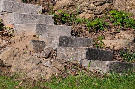 oudoor: Old gray concrete stairs oudoor next to rock cliff