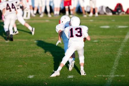 linemen: Quarterback during a game with his quarterback waiting for the snap.