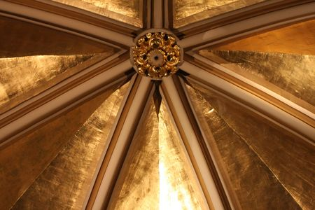 An ornate golden ceiling in an old church