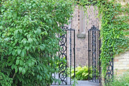 An iron garden entrance gate in black Stock Photo