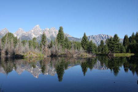 The Grand Teton Mountain range reflecting in a lake