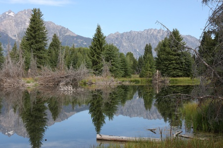 Mountains reflecting in a pond photo
