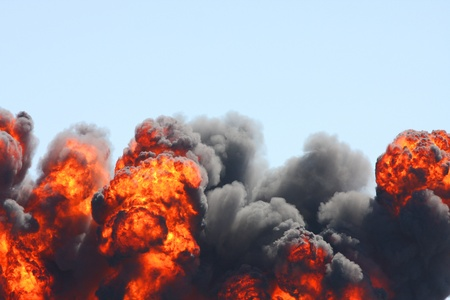 Explosion of dark clouds and flames billowing into the air