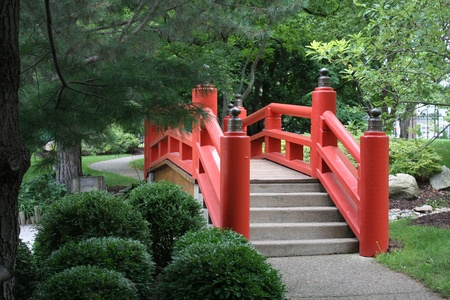 a red japanese garden bridge stock photo 12422236
