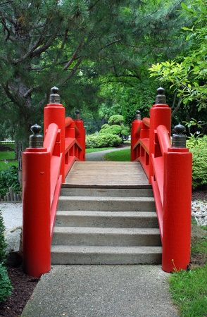 A red japanese garden bridge and path Stock Photo