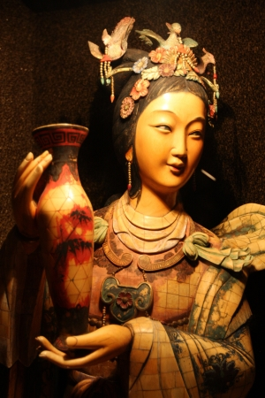 Japanese woman statue holding an oriental vase Stock Photo