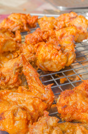 Hot fried chicken wings sale in the fresh food market at Rayong Thailand photo