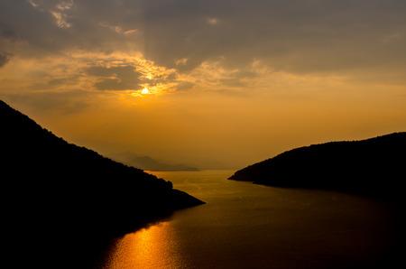 spiritless: Orange sunset and sunbeam on the big river