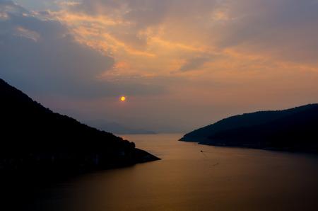 spiritless: Orange sunset on the big blue mountain range